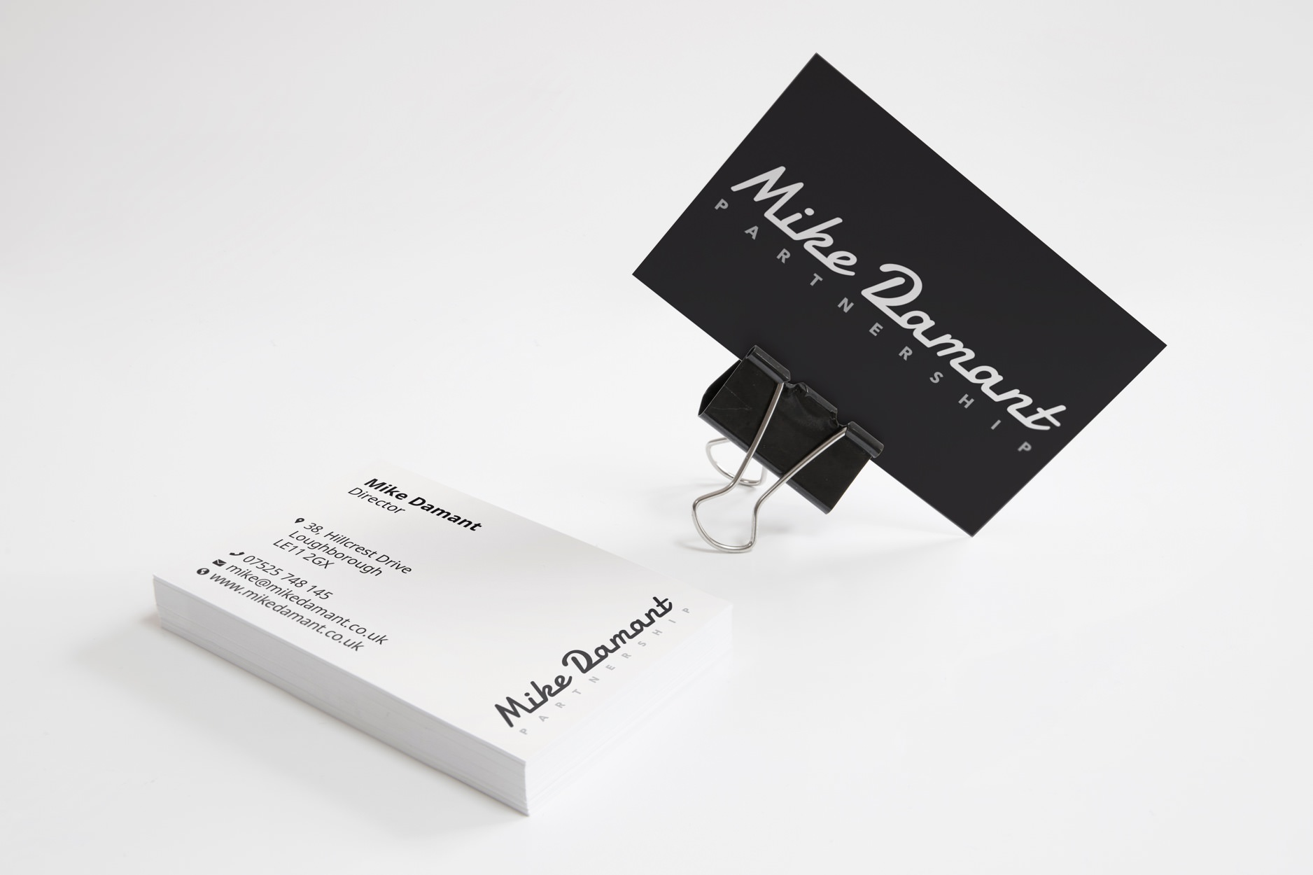 Business card for Mike Damant Partnership.